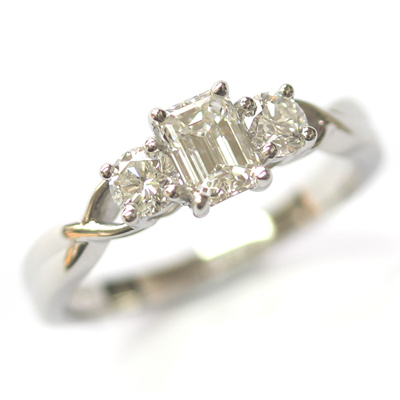 Emerald Cut and Round Brilliant Cut Diamond Trilogy Engagement Ring 1.jpg