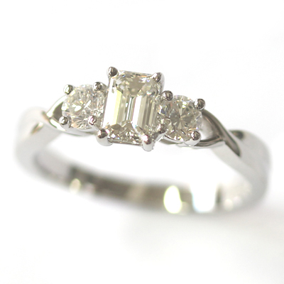 Emerald Cut and Round Brilliant Cut Diamond Trilogy Engagement Ring 3.jpg