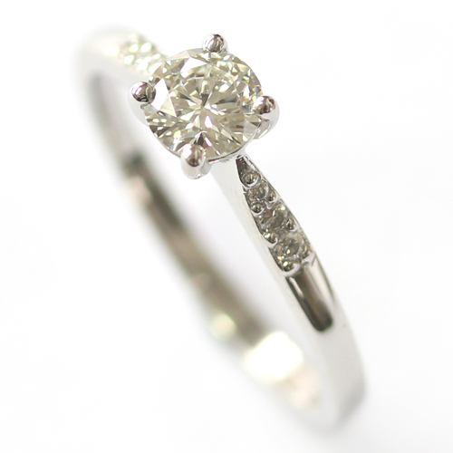 Platinum Engagement Ring with elegant Diamond Detail.jpg