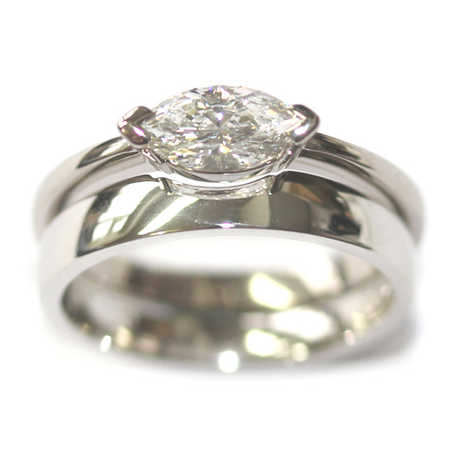 Platinum Fitted Wedding for a Solitaire Marquise Engagement Ring.jpg