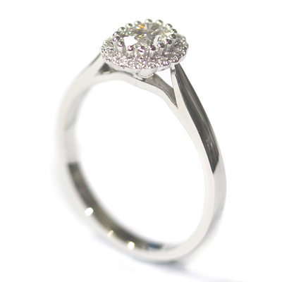Platinum Oval Cut Diamond Halo Engagement Ring 3.jpg