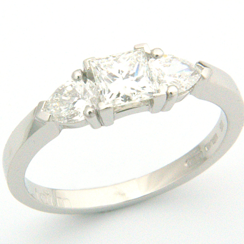 Platinum Princess and Pear Cut Diamond Trilogy Engagement Ring.jpg