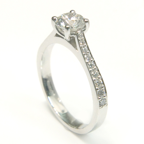 Platinum Round Brilliant Cut Diamond Engagement Ring with Diamond Set Shoulders.jpg