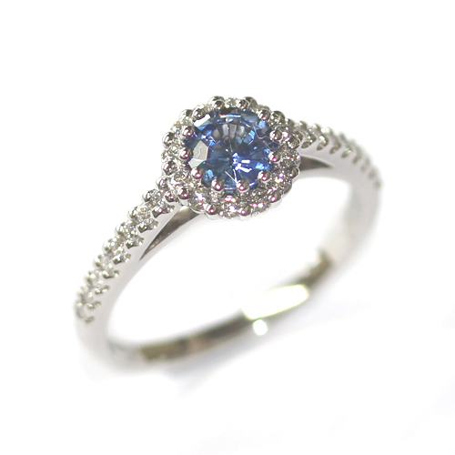 Platinum Sapphire and Diamond Halo Style Engagement Ring.jpg