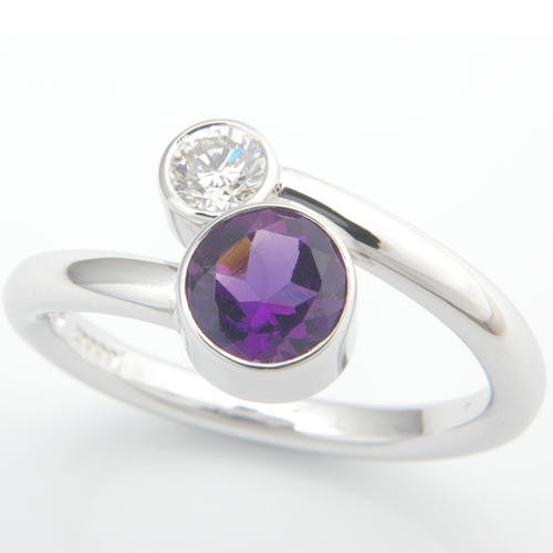 18ct White Gold Amethyst and Diamond Crossover Ring.jpg