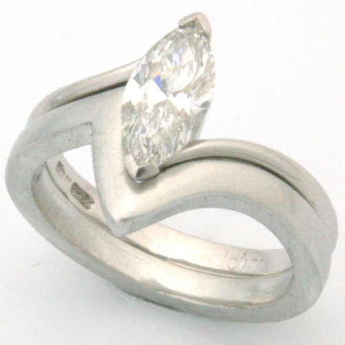 Platinum Fitted Wedding Ring to Marquise Cut Diamond Engagement Ring.jpg