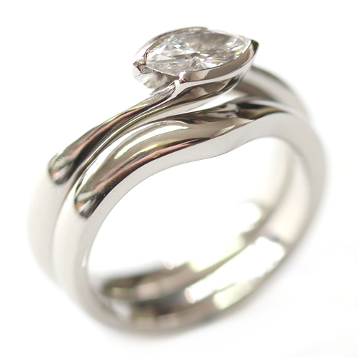Plain Platinum Fitted Wedding Ring to Solitaire Marquise Diamond Engagement Ring.jpg