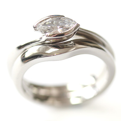 Plain Platinum Fitted Wedding Ring to Solitaire Marquise Diamond Engagement Ring 2.jpg