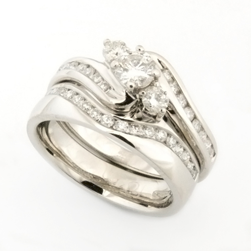 Platinum Diamond Fitted Wedding Ring to Trilogy Wave Engagement ring ring.jpg