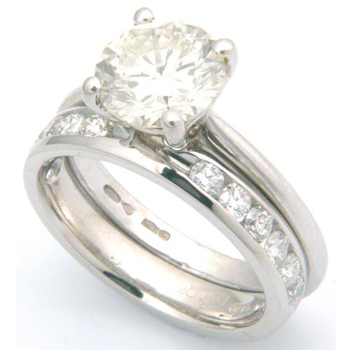 Platinum Channel Set Diamond Fitted Wedding Ring.jpg