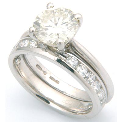 Platinum Channel Set Diamond Fitted Wedding Ring 1.jpg