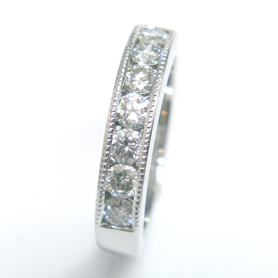 Platinum Channel Set Diamond Eternity Ring with Millgrain Details 2.jpg