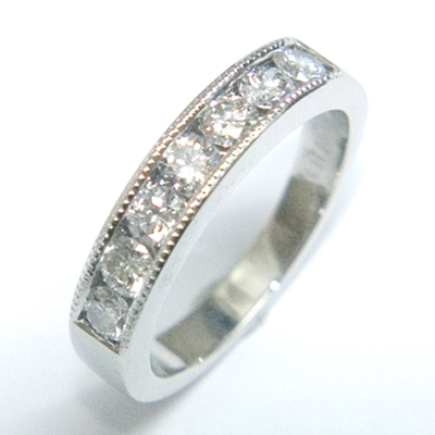Platinum Channel Set Diamond Eternity Ring with Millgrain Details 3.jpg