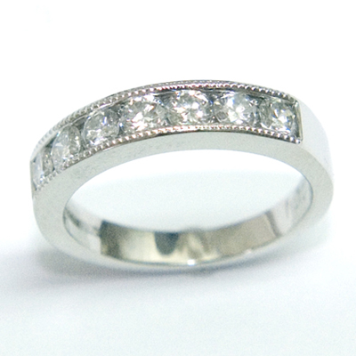 Platinum Channel Set Diamond Eternity Ring with Millgrain Details 1.jpg
