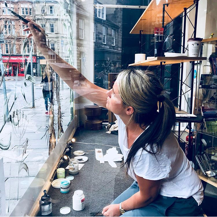 Painting on the windows in Paper Tiger., Edinburgh