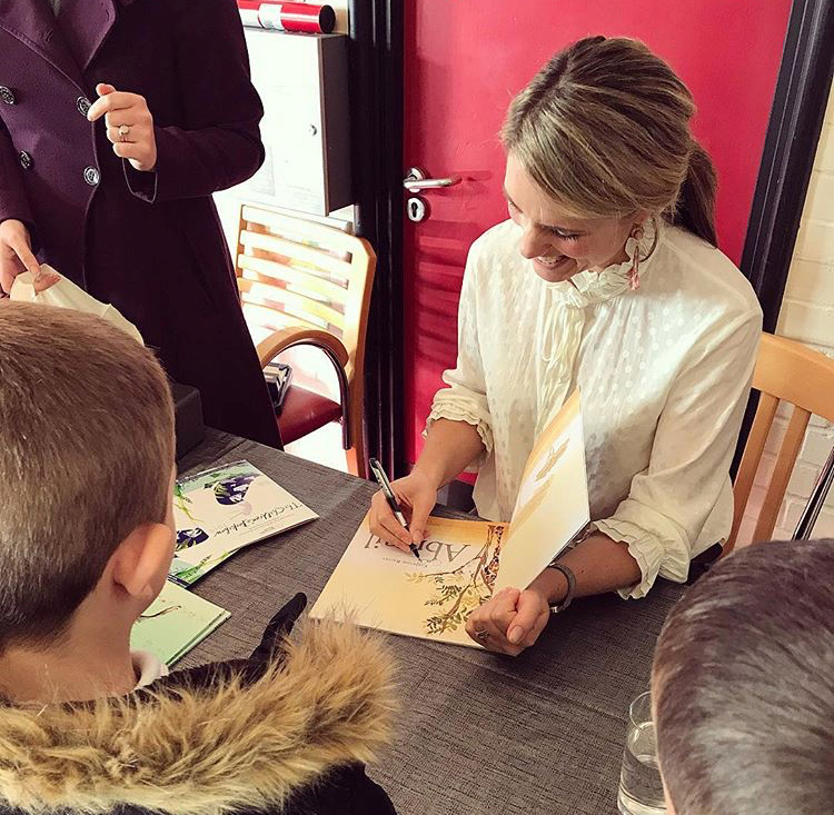 Signing books whilst on tour with 'The Children's Bookshow'