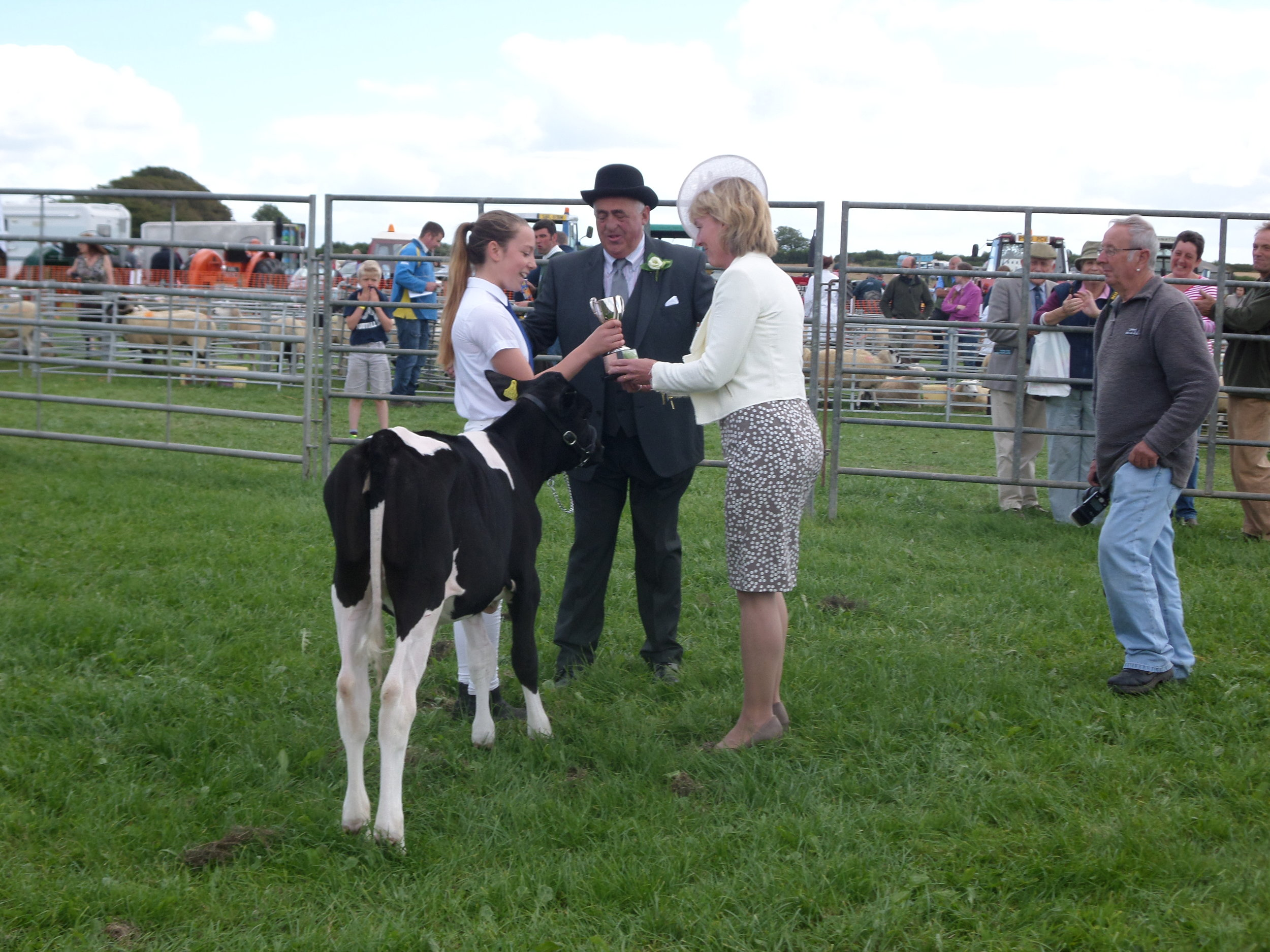 Abi Marshall, winner of Ken Jones Cup for Young Handlers with Mr and Mrs Bone