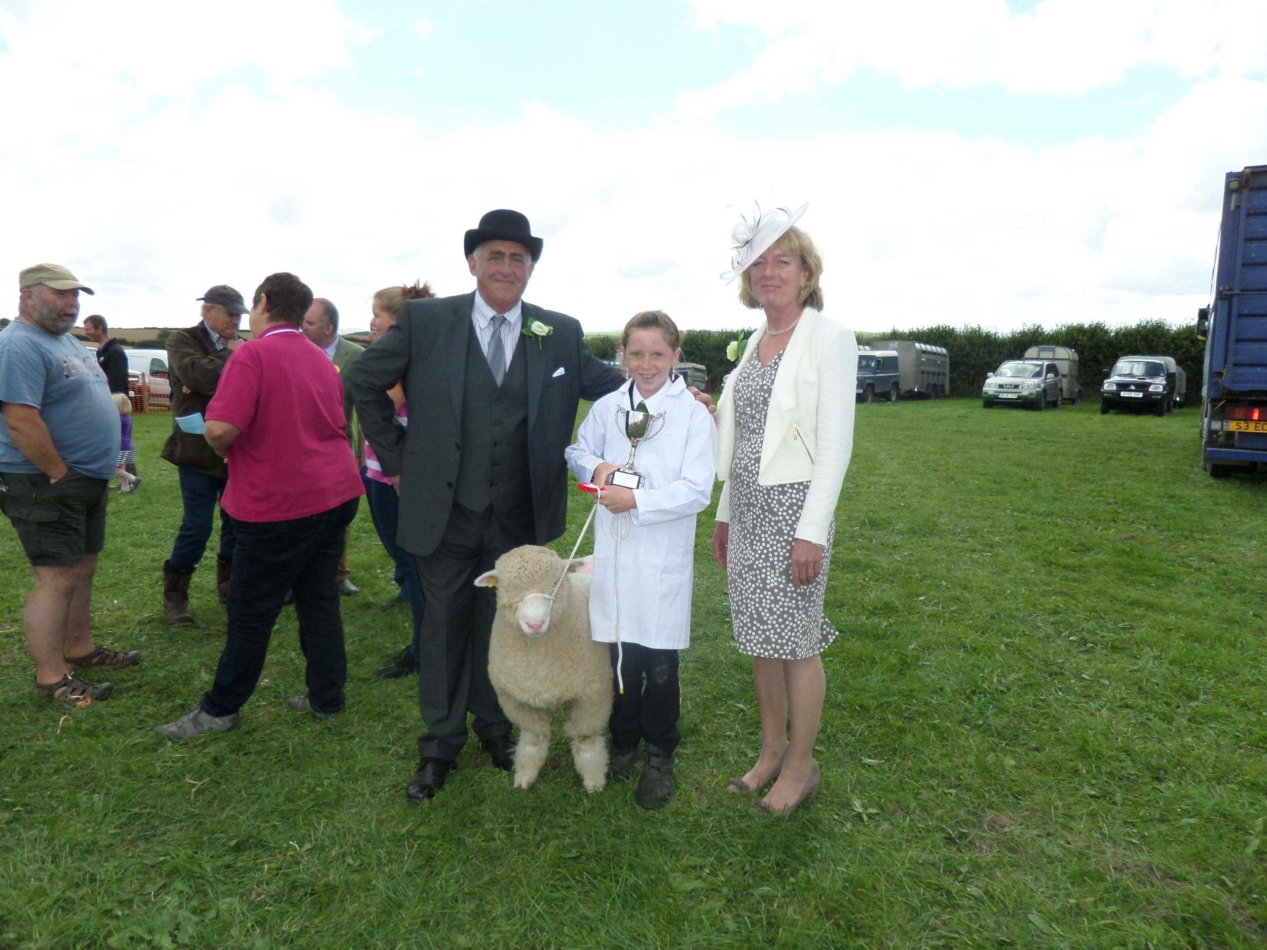 Holly Pennells, winner of Mr and Mrs G King cup for Young Handlers with President John Bone and his wife Helen