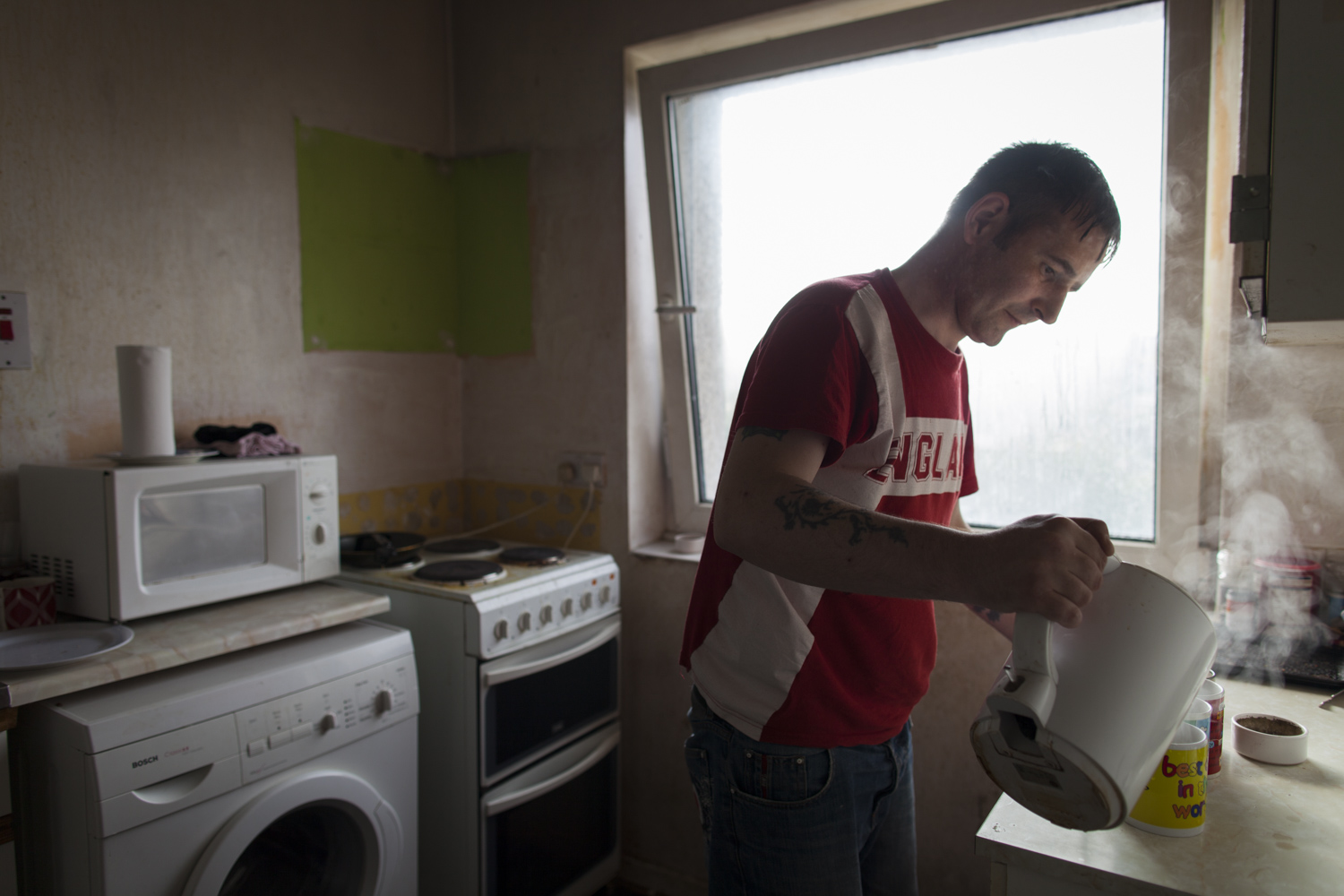 """Sean in his kitchen.  """" Sean didn't want the help, but I did. I needed it, and it helped me sort my head out. And then after I'd got off the drugs and got clean and stayed away from it all…"""""""