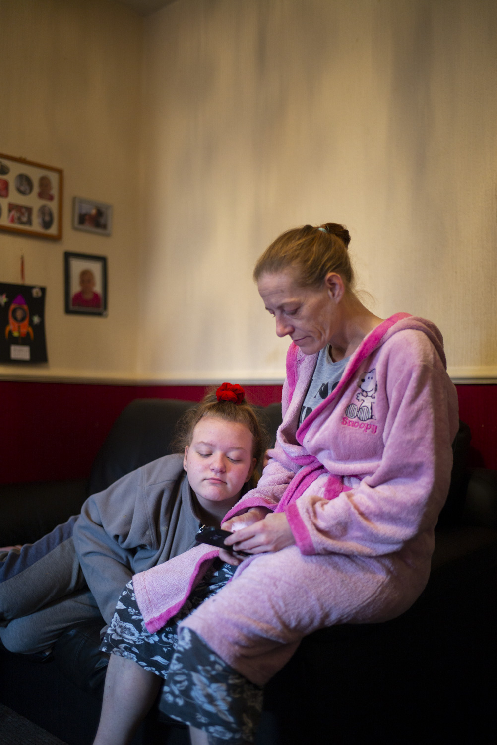 """Claire with Colin's daughter, Kayleigh.  """" Here in Blackpool the benefit system is just starting everybody on Universal Credit. I don't like this because it is messing everybody up. It changes everybody. Their telling everybody to take five weeks but really, it's taking anywhere up to 12 to 15 weeks which is putting people into debt with their rent, Council tax, and various other issue things. At the minute they're changing me over to Universal Credit. They haven't given me a proper payment from them as of yet, I'm still waiting. On my ESA (Employment Support Allowance), they took me off that because they said even though because of my chronic pain syndrome and health issues, they said I could still physically work…"""""""