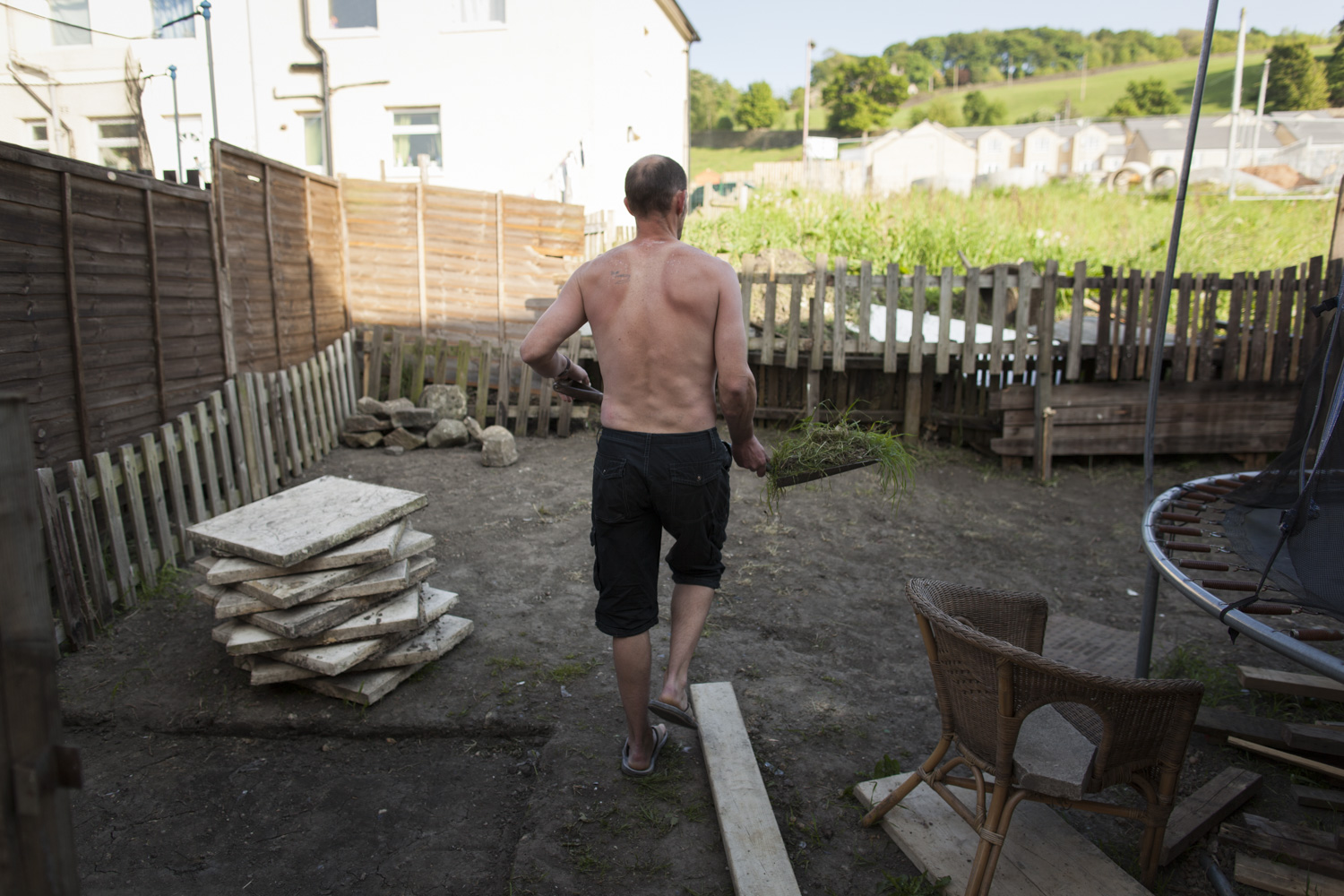 Dean working on the back garden. It's part of his plan to create a turfed garden for the kids to play in.
