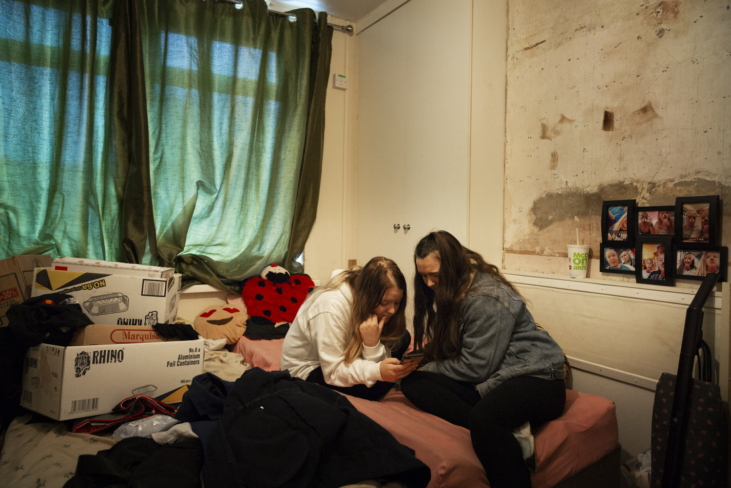 "Kayleigh in her bedroom with Millie.      ""And then she comes back with lots of apologies and all the teachers are happy, and two days later it all happens again…"""