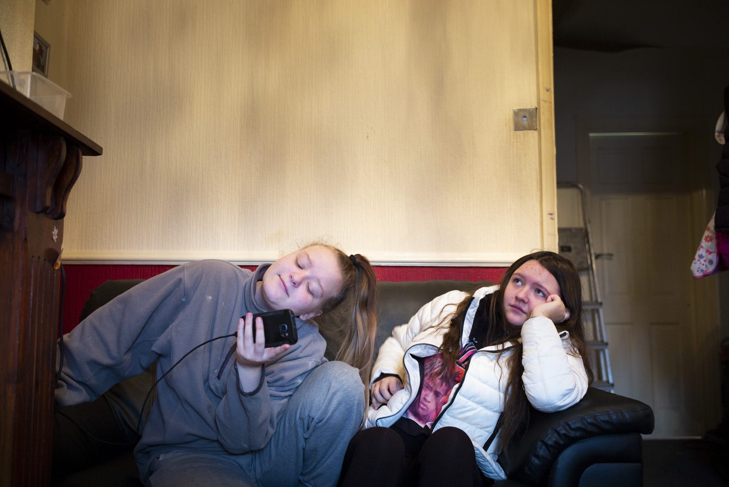 """Millie with Kayleigh at Claire's flat.      """"I've had to go to food banks which is quite depressing. It's a bit humiliating. It's embarrassing. But then I've appealed and I've actually won two appeals. But this last time, when they did it to me, because I actually, with all the stress, I had a lot of stress, with Millie not going to school and having to go to court and everything, and my depression was really bad. And I've been to hospital quite a few times…"""""""