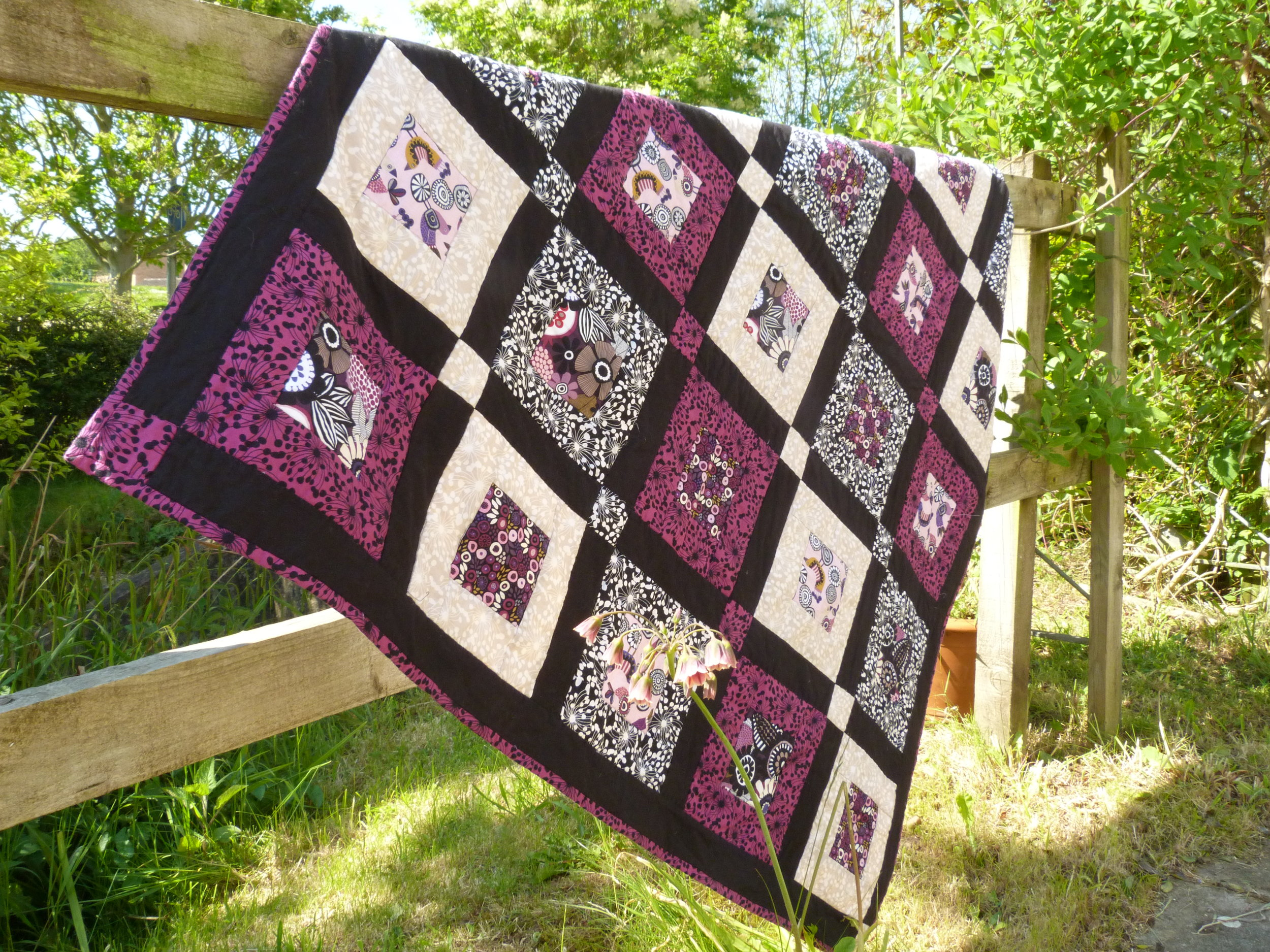 Birds and Blooms quilt mywork.JPG