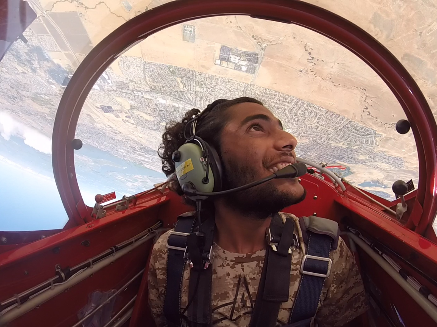 Aerobatics - No previous experience necessary.You take the controls of the airplane and learn how to fly loops, rolls, inverted and more.