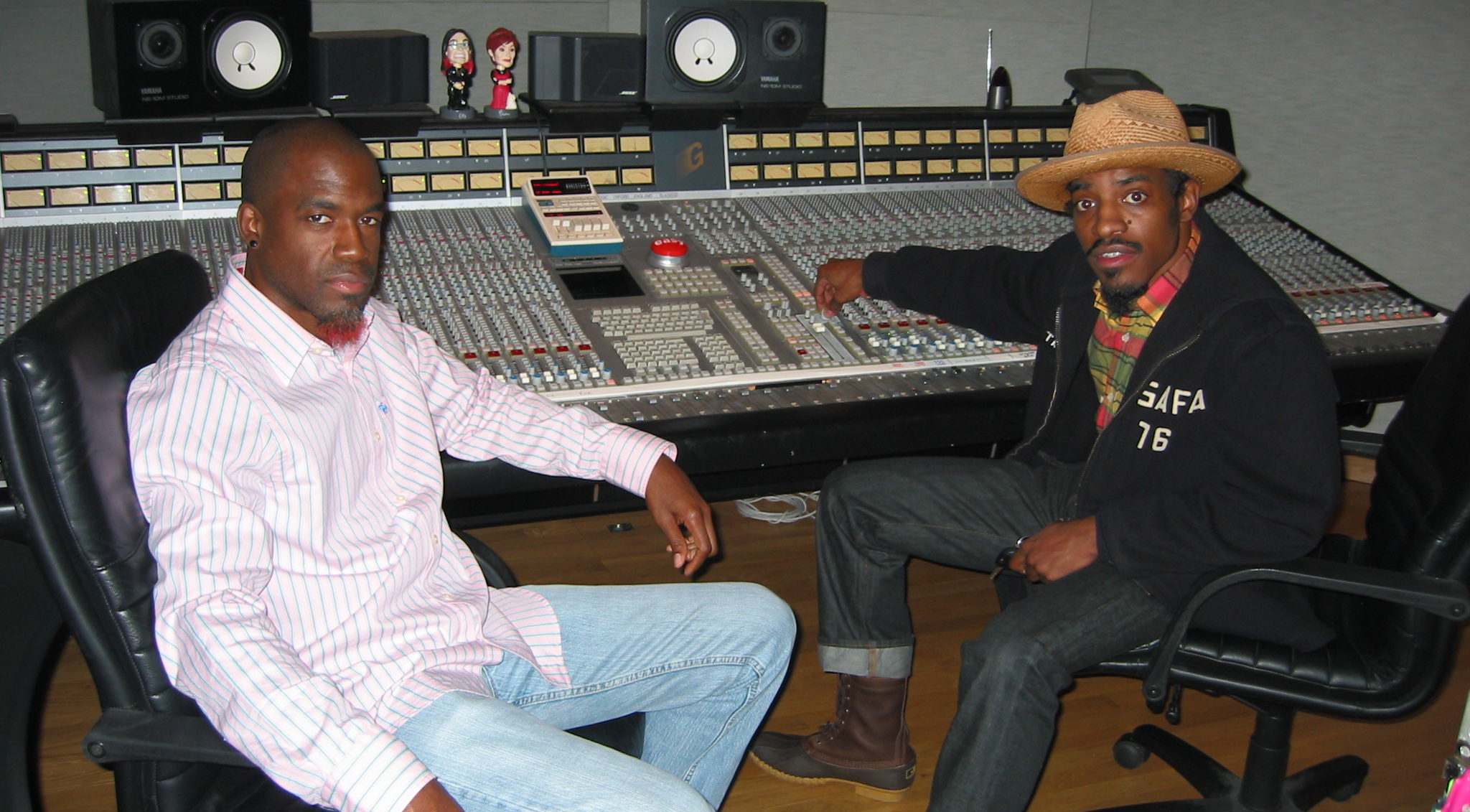 Producer/Engineer Neal Pogue with Andre 3000 and a beautiful SSL mixing console.