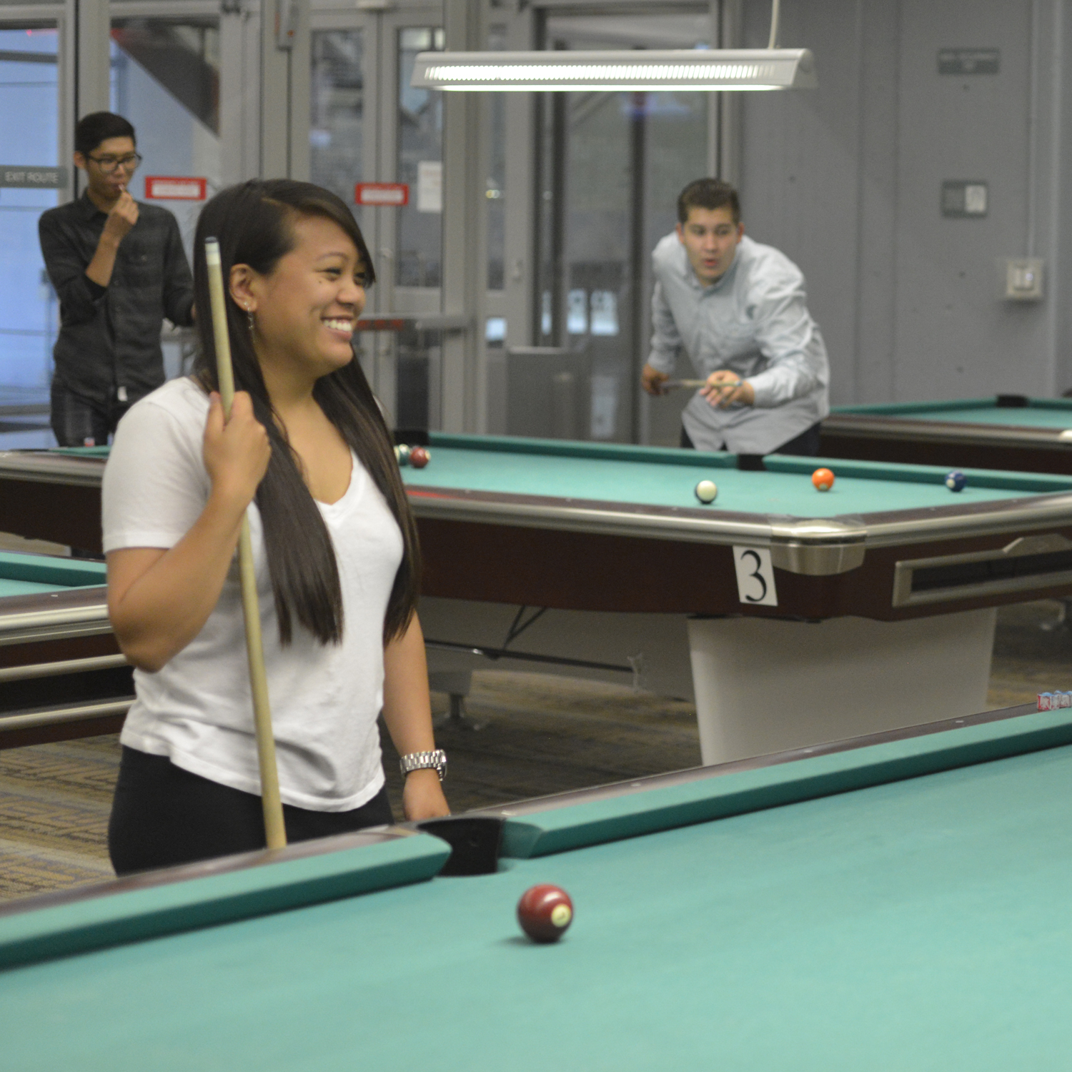 Photo of student playing pool.