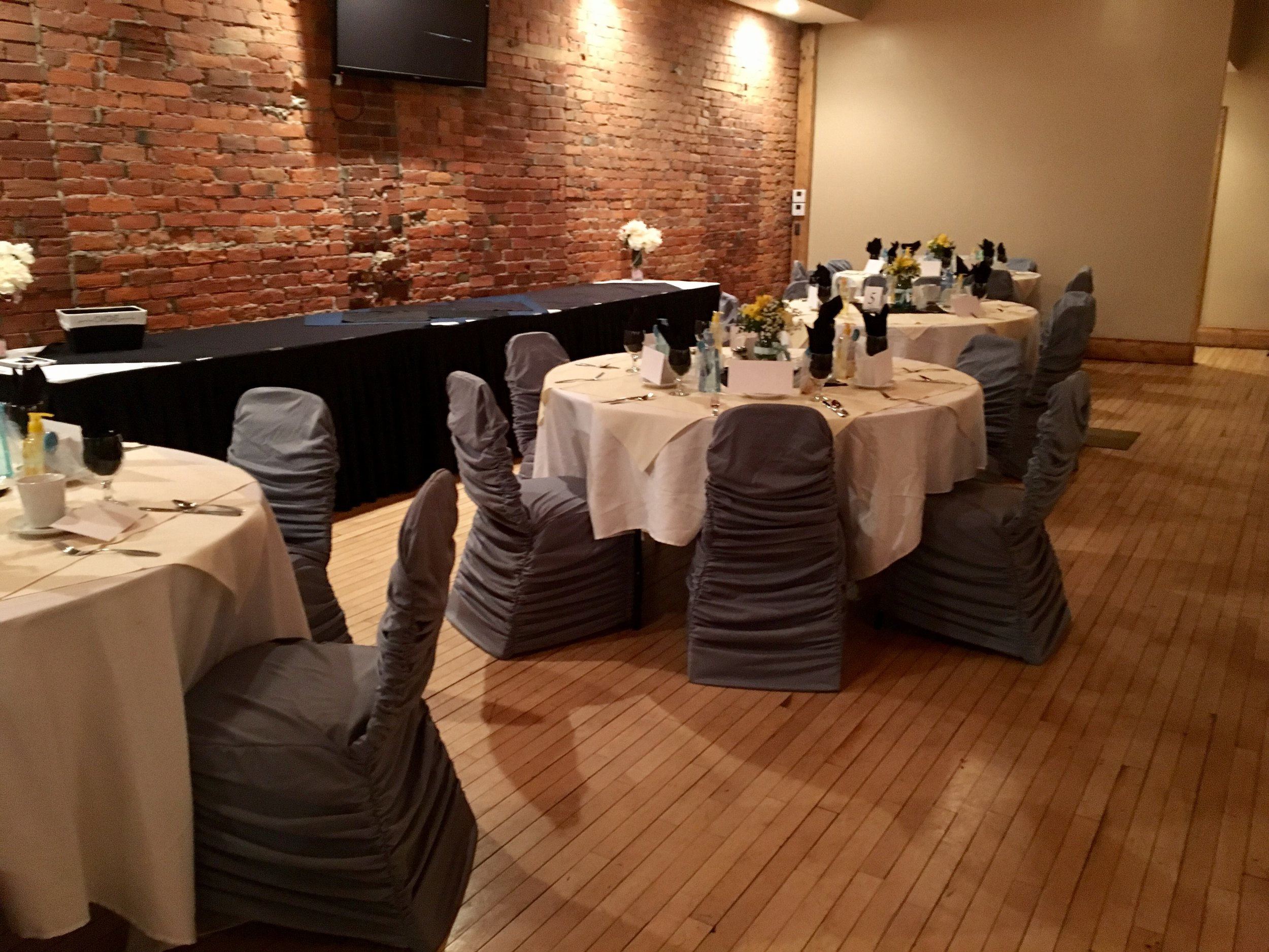 banquet room setup with chair covers.jpg