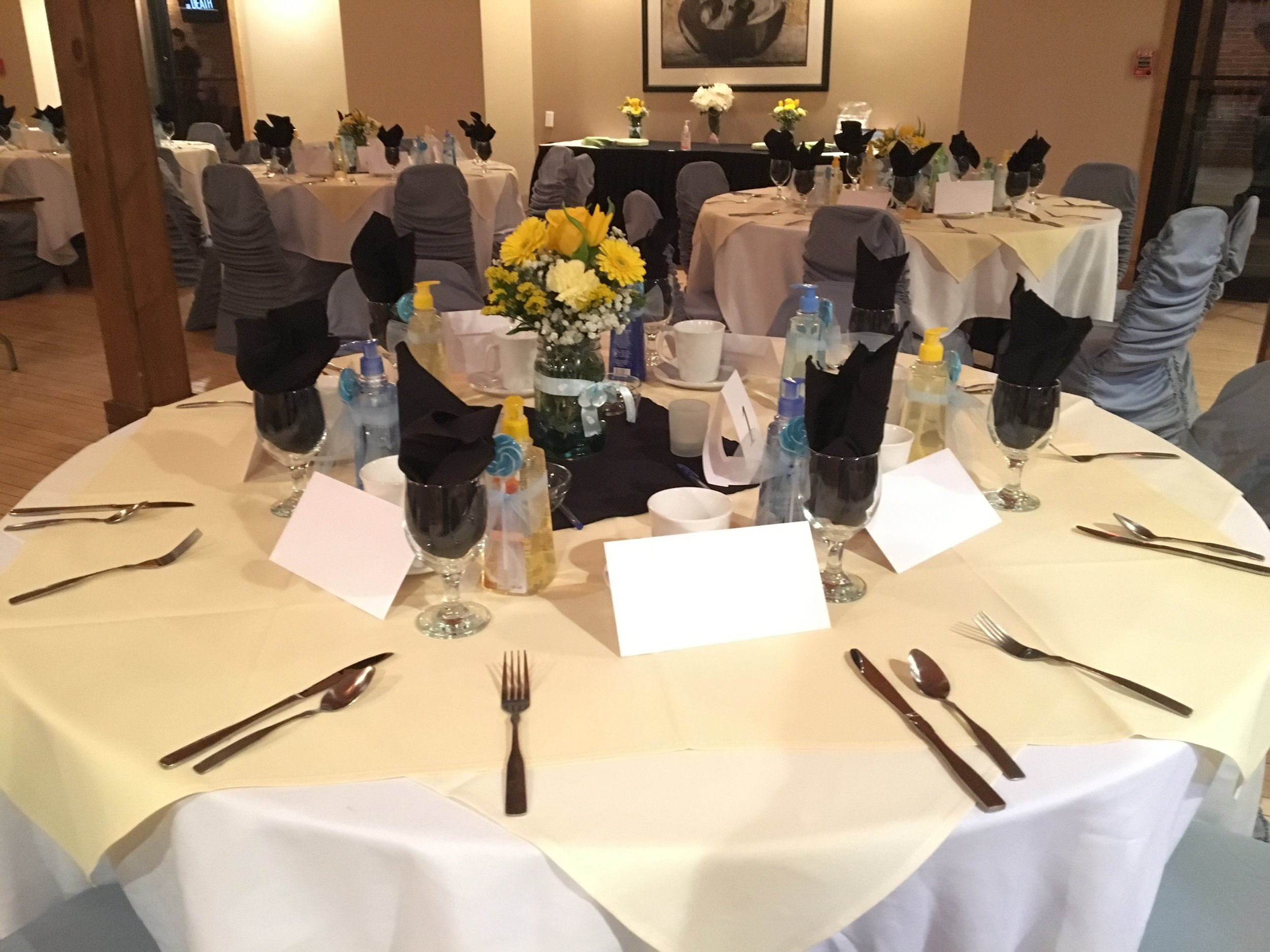 banquet room setup with chair covers 2.JPG