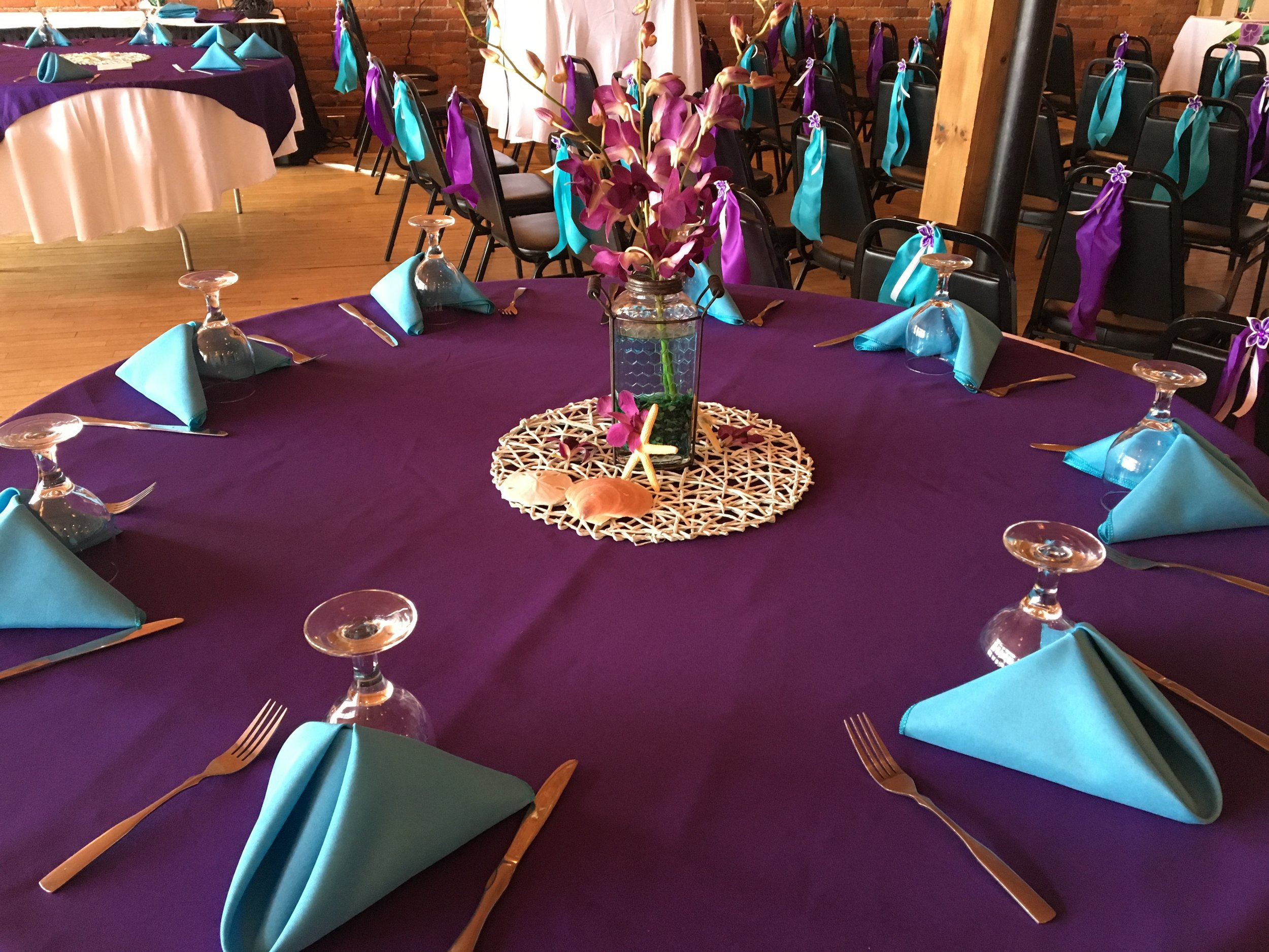 Purple and teal banquet setup.JPG
