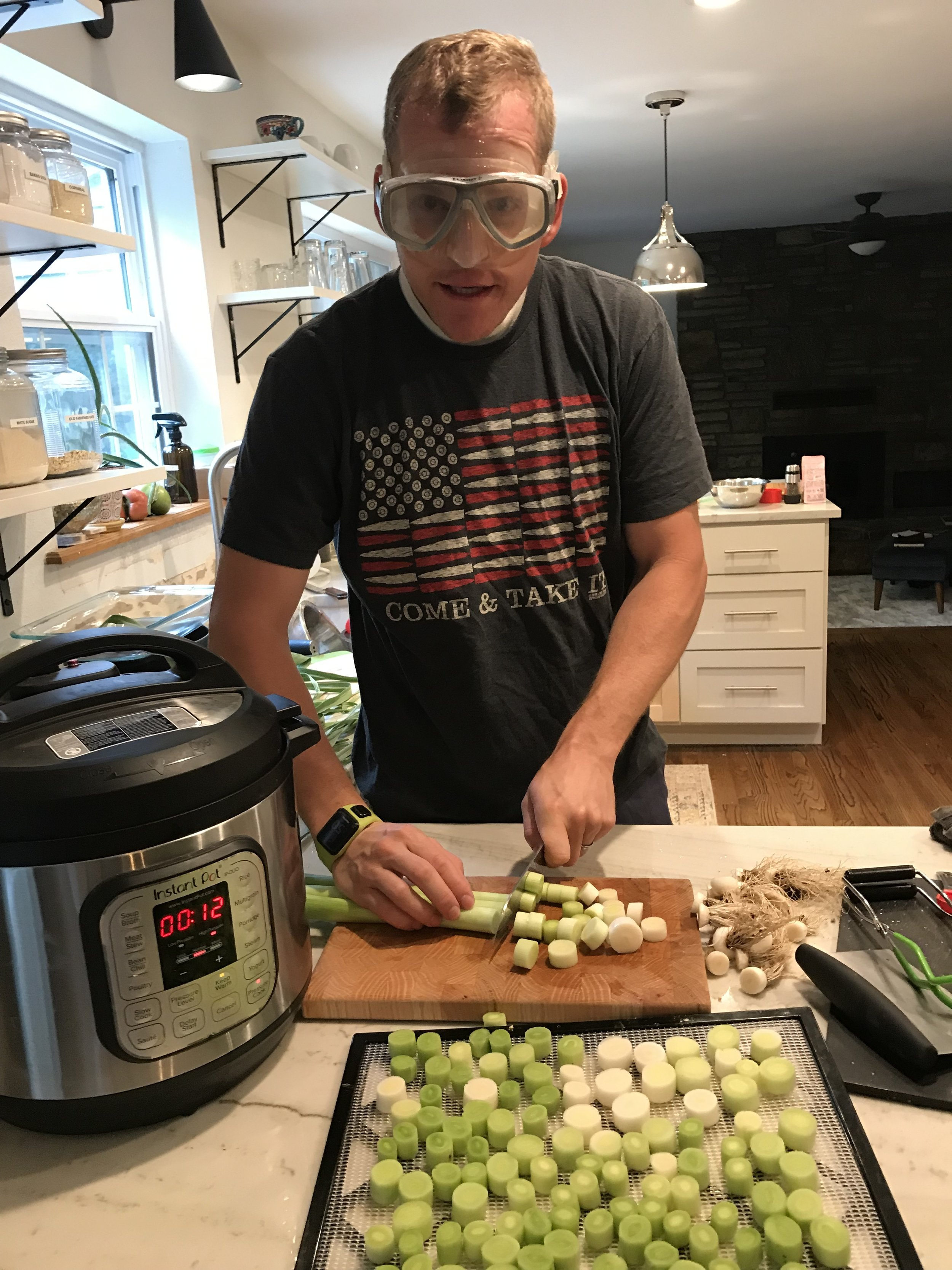I hope Cameron doesn't see this picture- he might want me to take it off the blog! Haha! He was helping cut leeks for the dehydrator and man they sting your eyes so much when they are fresh. Swim goggles do the trick to keep the tears at bay!