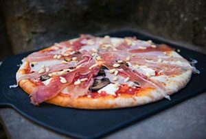 Outdoor pizza oven evening meal