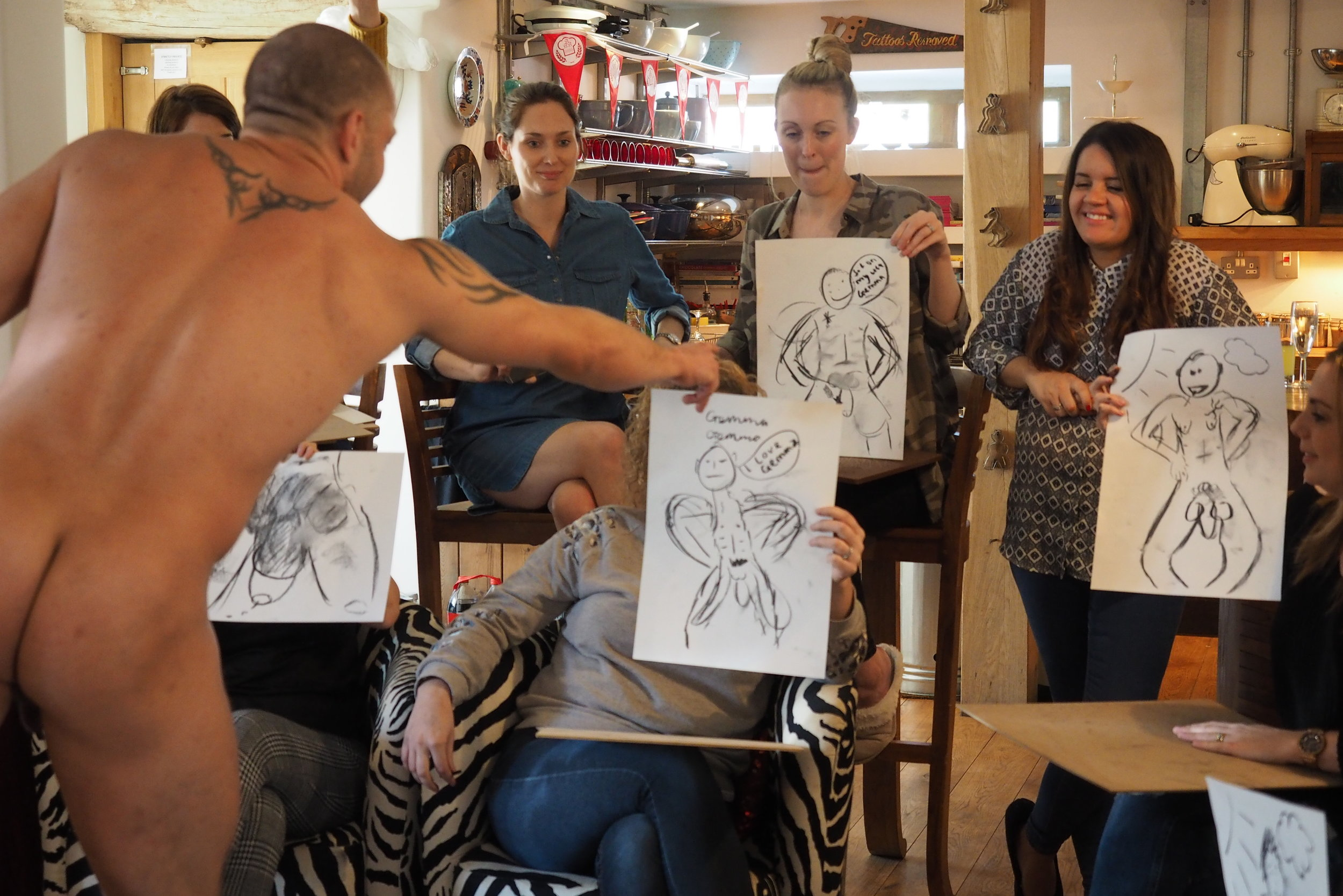 Life drawing art Class  Life drawing class with a butt naked male model.