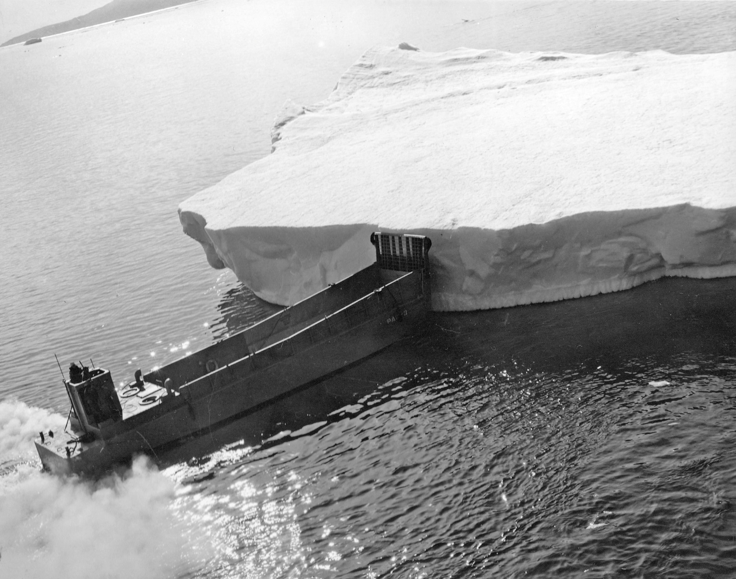 An LSM diverted from hauling cargo to move an iceberg.
