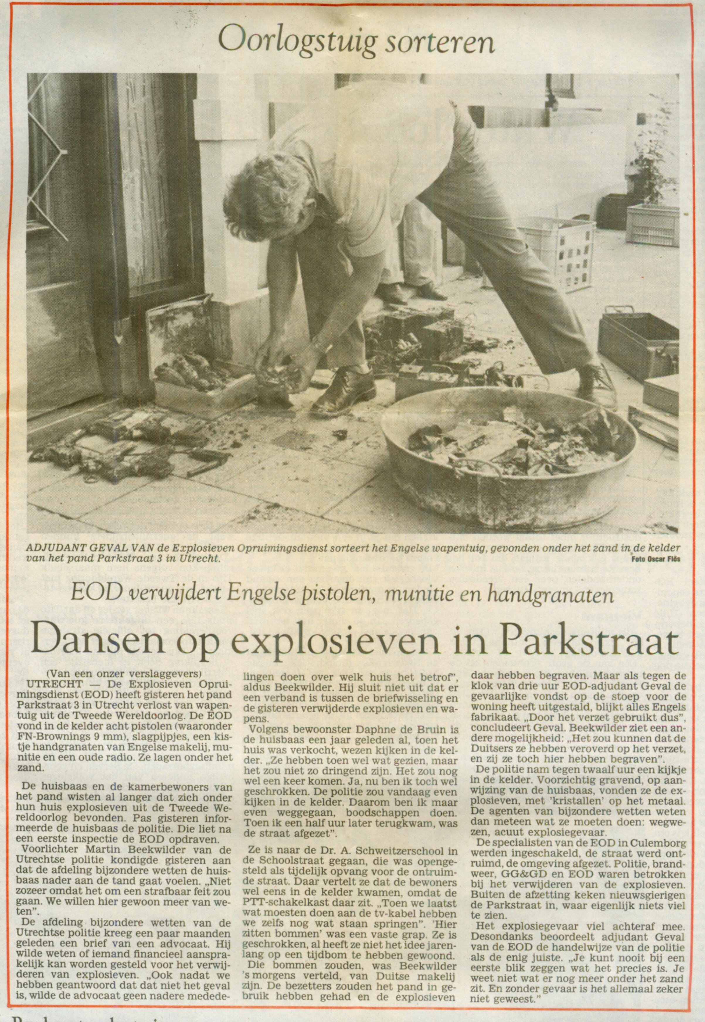 A newspaper clipping showing the weapons and radios pulled from the basement of #3 Parkstraat in Utrecht.