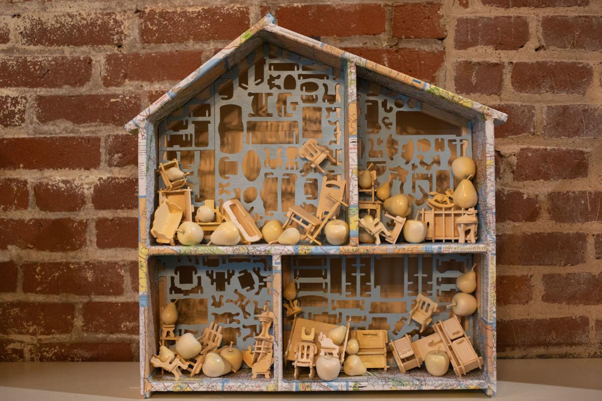 """""""Home is a State of Mind,"""" by Pam Winegard, is among the pieces in the exhibition """"No Place Like Home,"""" which features 25 dollhouses to honor the 25th anniversary of Miriam's House.  Emily Elconin/The News & Advance"""