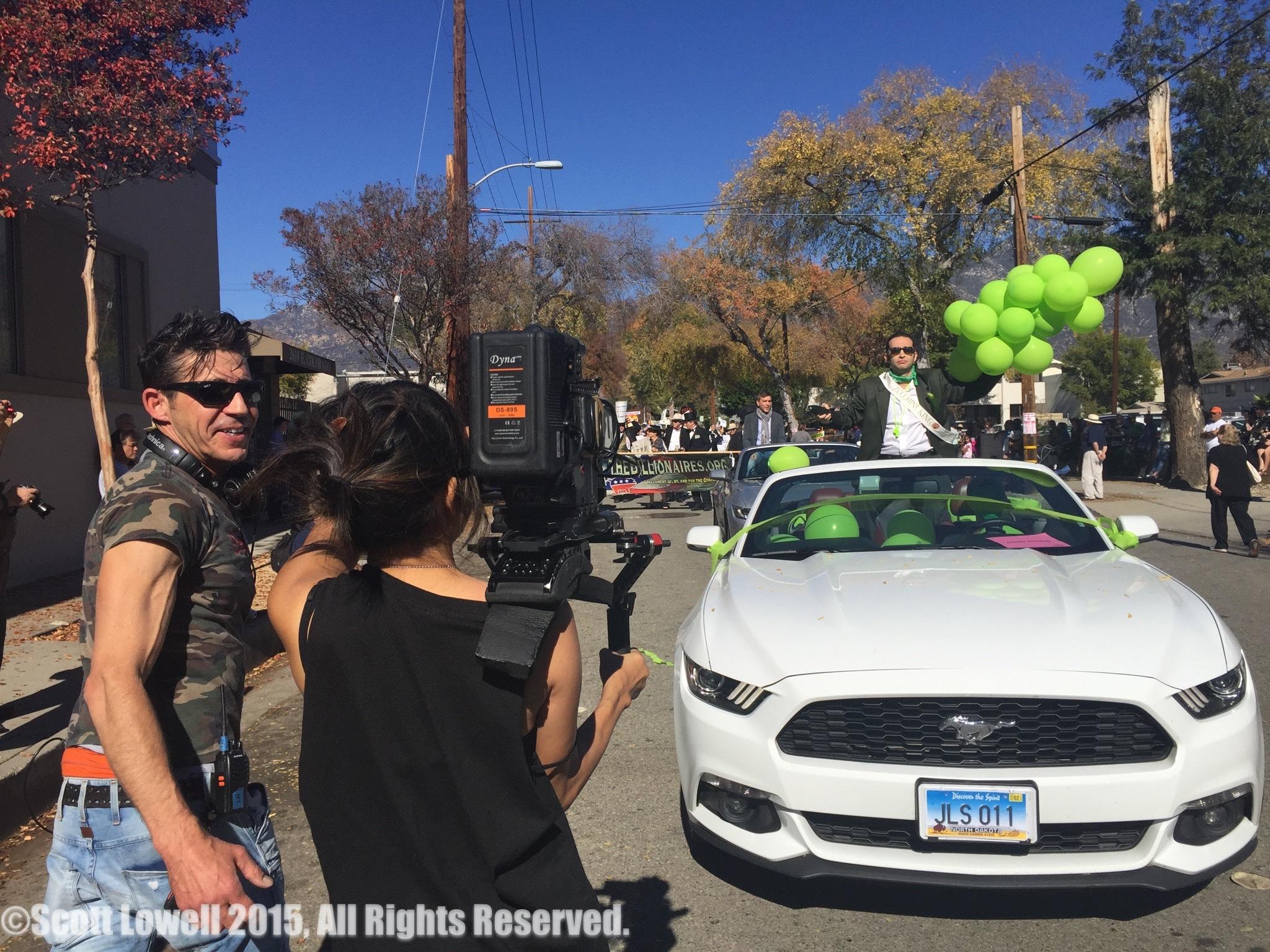 "11/22/15 Parade Scene. L to R: Monty Miranda (Dir.), Shirley Petchprapa (D.P.), Scott Lowell, Spencer Berger (""Zucchini King"")"