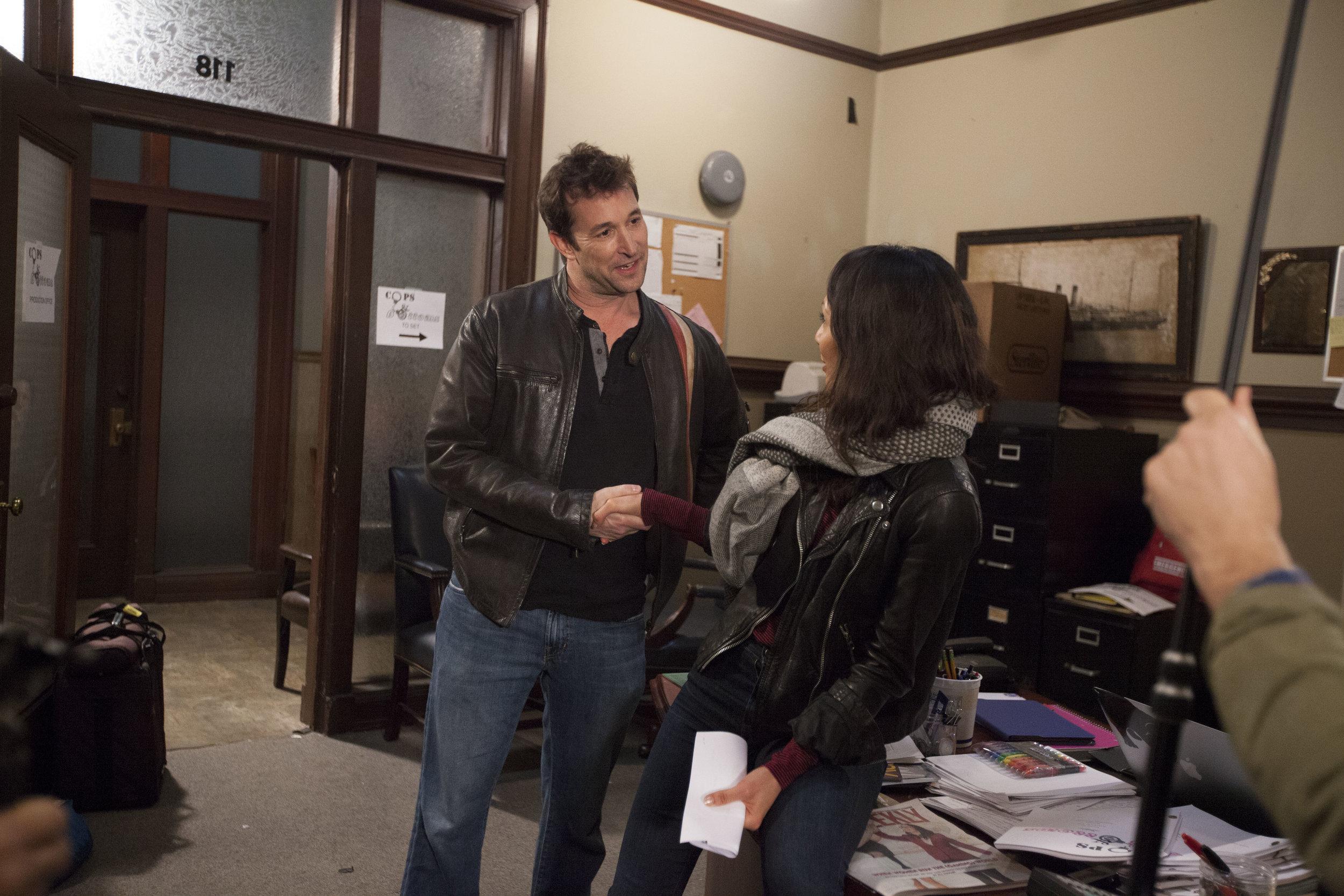 """1/16/16 Cops & Bottoms Production Office Scene. L to R: Noah Wyle (""""Noah""""), Linda Park (""""Jennifer"""")"""