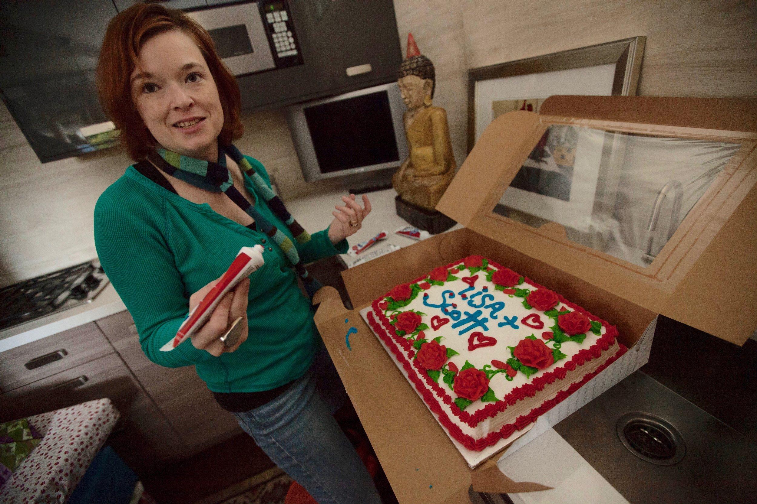 1/17/16 Garden Party Scene. Exec. Prod. Corinne Marrinan ices the cake.