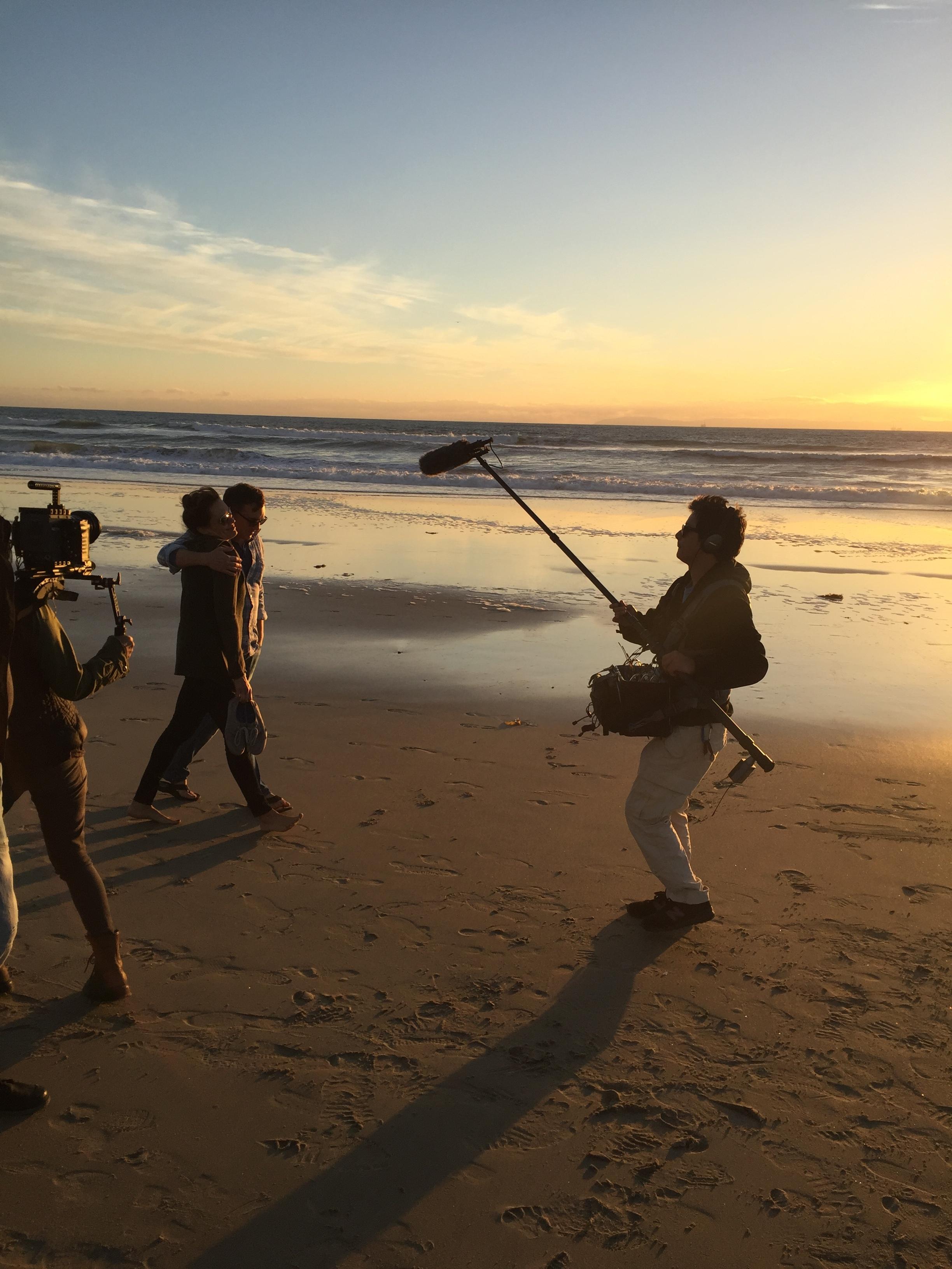 "12/13/15 Sunset Beach Scene Scene. L to R: Shirley Petchprapa (D.P.), Emily Swallow (""Lisa""), Scott Lowell, Kevin Rosen-Quan (Sound)"