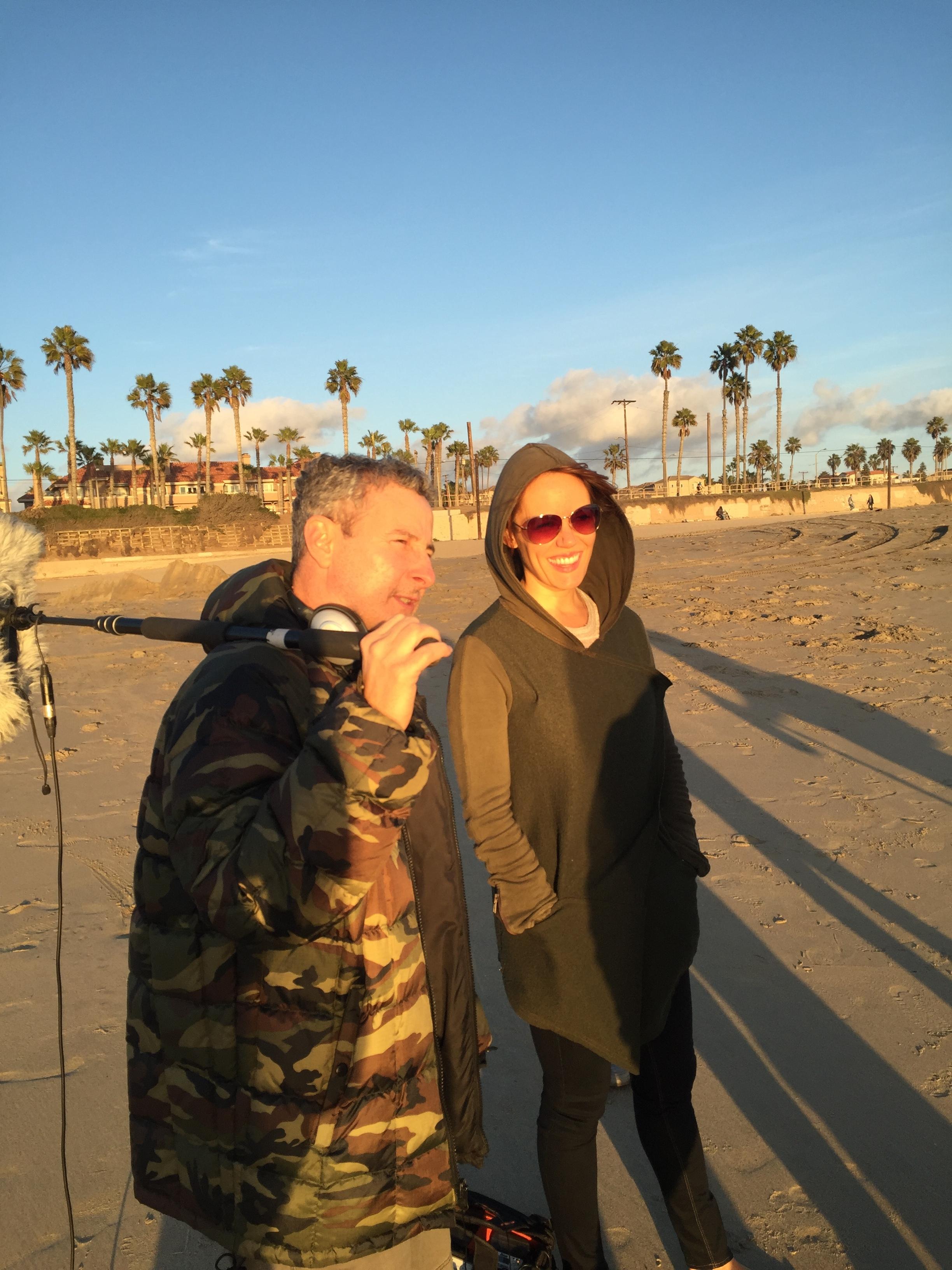 "12/13/15 Sunset Beach Scene Scene. L to R: Eddie Jemison (""Chaim""), Emily Swallow (""Lisa"")"