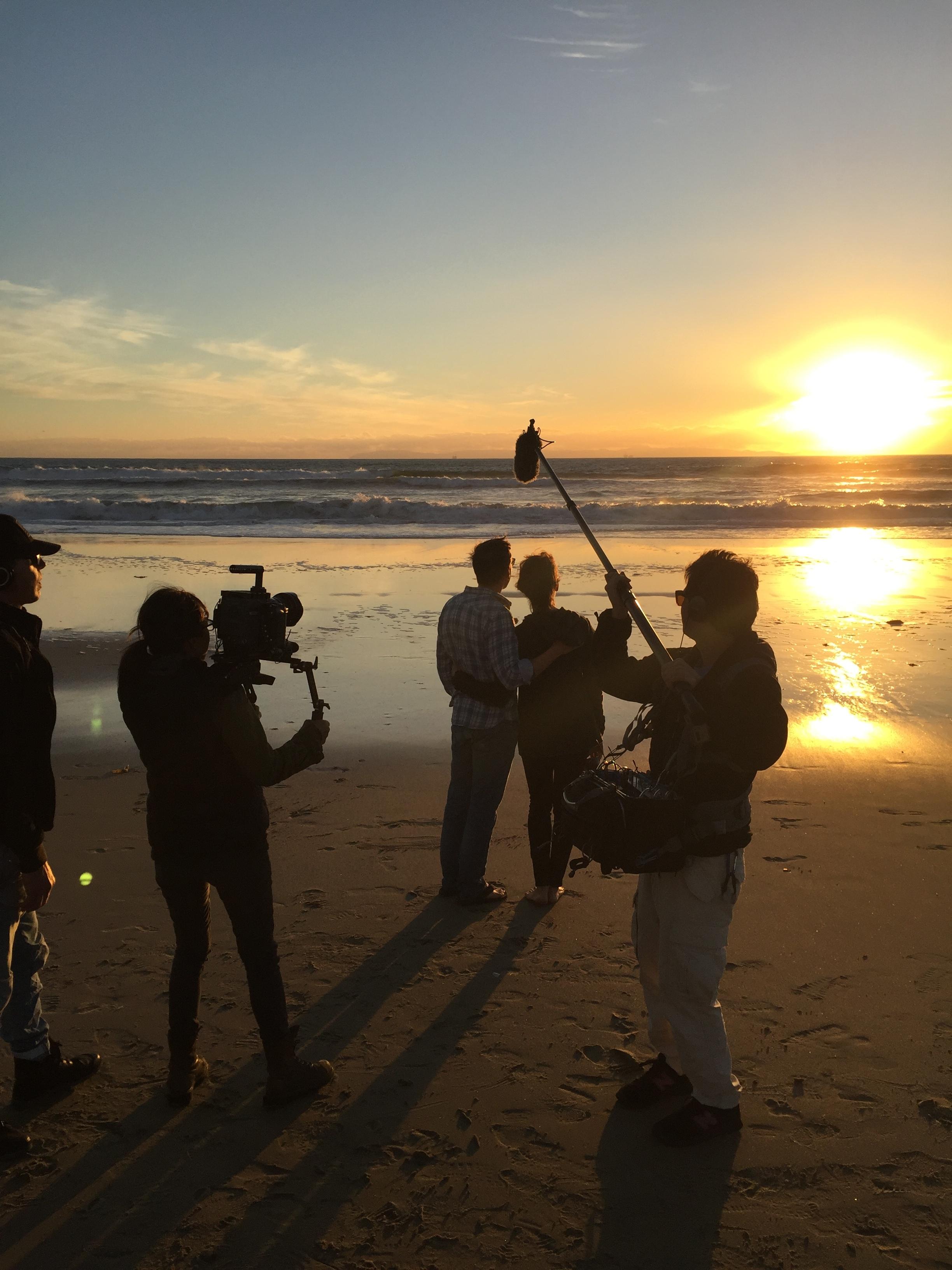 "12/13/15 Sunset Beach Scene Scene. L to R: Monty Miranda (Dir.), Shirley Petchprapa (D.P.), Scott Lowell, Emily Swallow (""Lisa""), Kevin Rosen-Quan (Sound)"