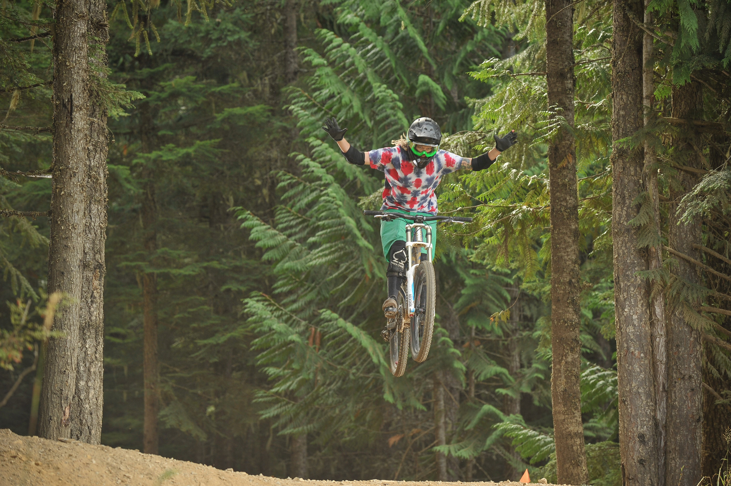 No-hander on A-line in the Whistler Bike Park. Photo credit: Coast Mountain Photography