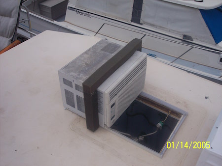 STEP 7 - A/C unit in place, Placement of foam is perfect, and Fastening A/C unit to Deck with brackets