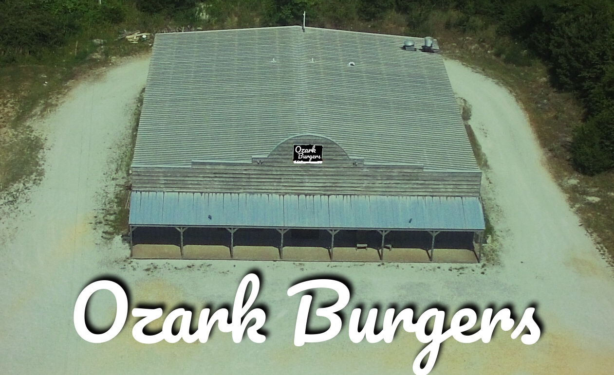 Restaurant  NOW OPEN.  Enjoy fresh burgers and all you can eat fries.    Still to come: The restaurant will have a storefront that Ozark Co-op Members can sell goods such as survival gear, fresh milk, soaps, heirloom seeds, fresh produce, and more.
