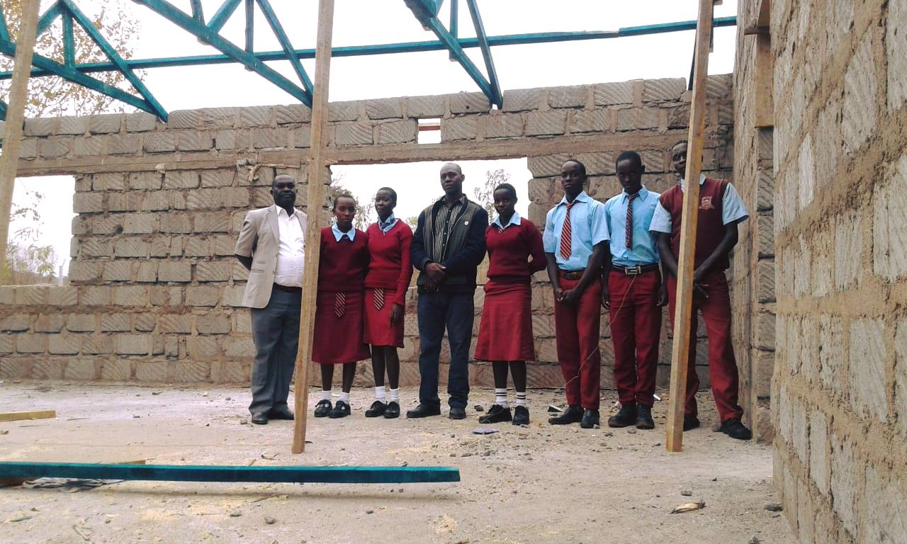 Masaani students with the principal and Rev. Michael our BBG representative.